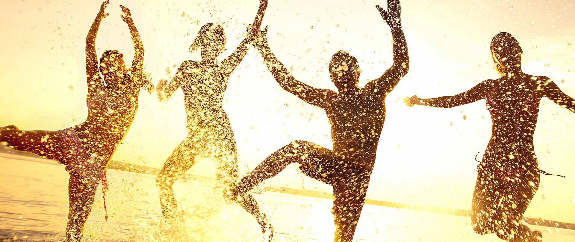 Silhouette of people playing in water
